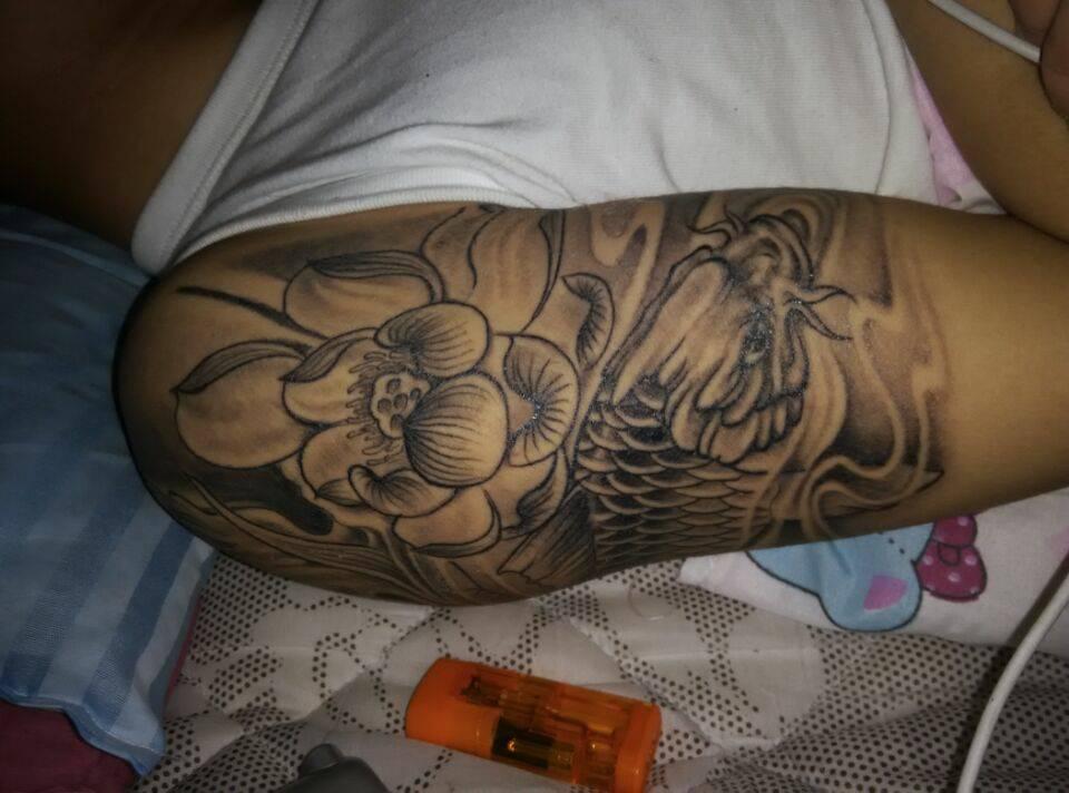 我身上有个鲤鱼纹身,都说纹身有讲,哪位大神给看看我这纹身好吗,有图片