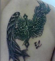 想纹身,左手臂纹条单一颜色的龙图片
