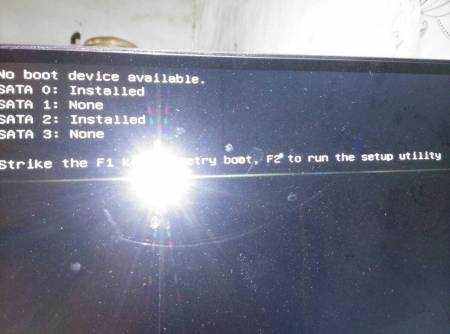 戴尔台式电脑开机时,显示f1f2,但是按f1却无法重启系统,显示一些中文图片